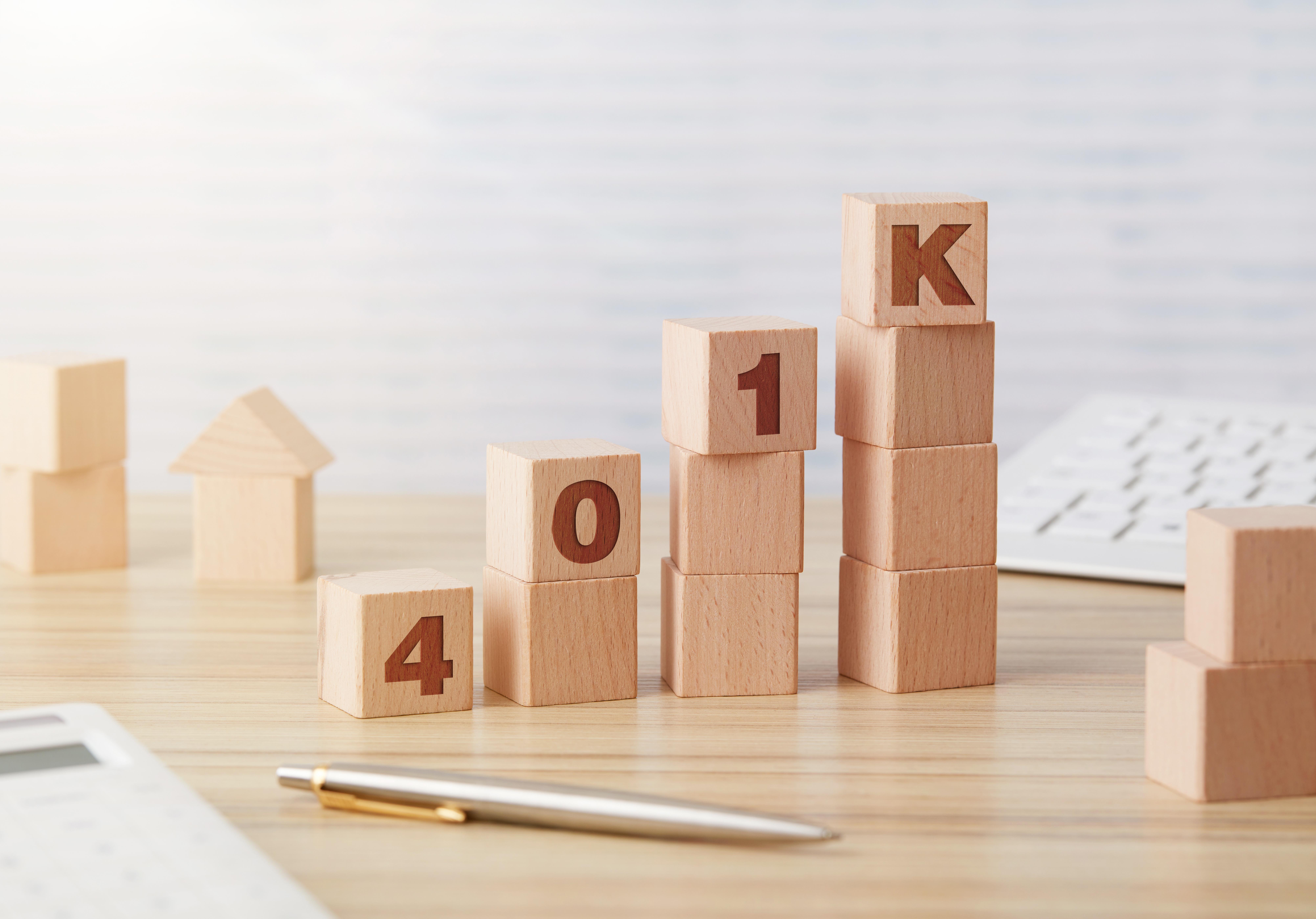 401K wooden blocks chart on desk