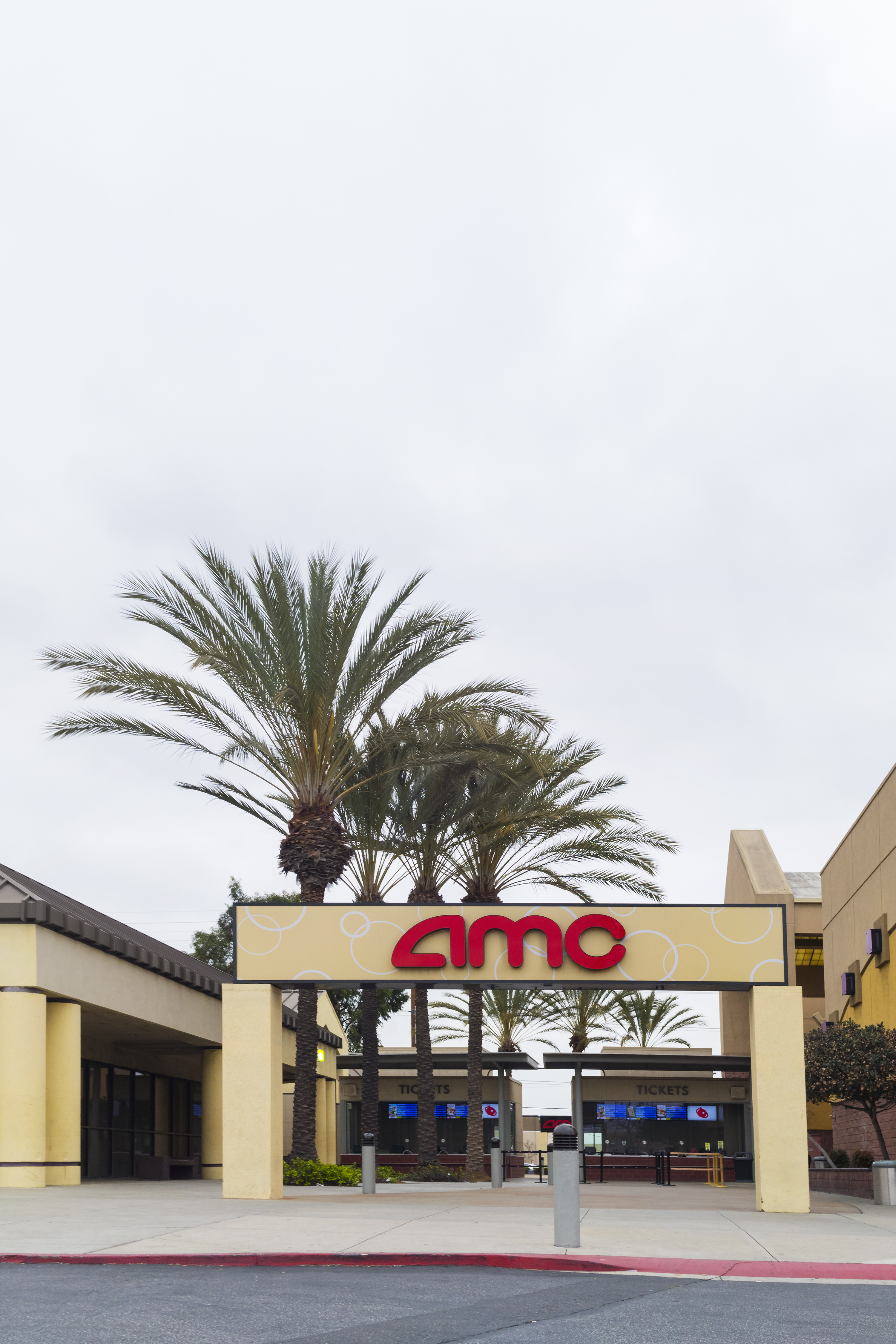 Fullerton, California, USA - April 3, 2018: AMC theatre entrance sign in Fullerton, California. AMC Cinemas is the largest movie theater chain in the world, and also the largest in the United States.