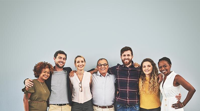 Diverse group of happy associates bonding