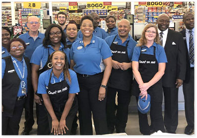 A diverse group of happy store associates near the front of the store