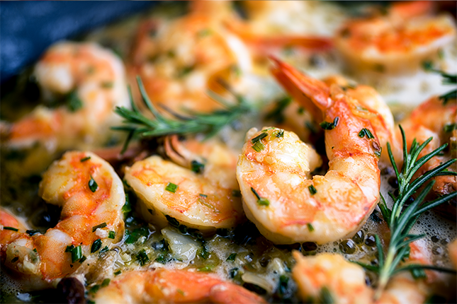 Freshly Cooked Frozen Shrimp with herbs ans spices.