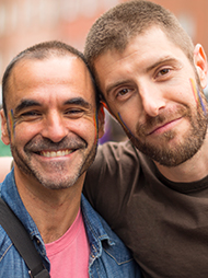 Smiling male couple