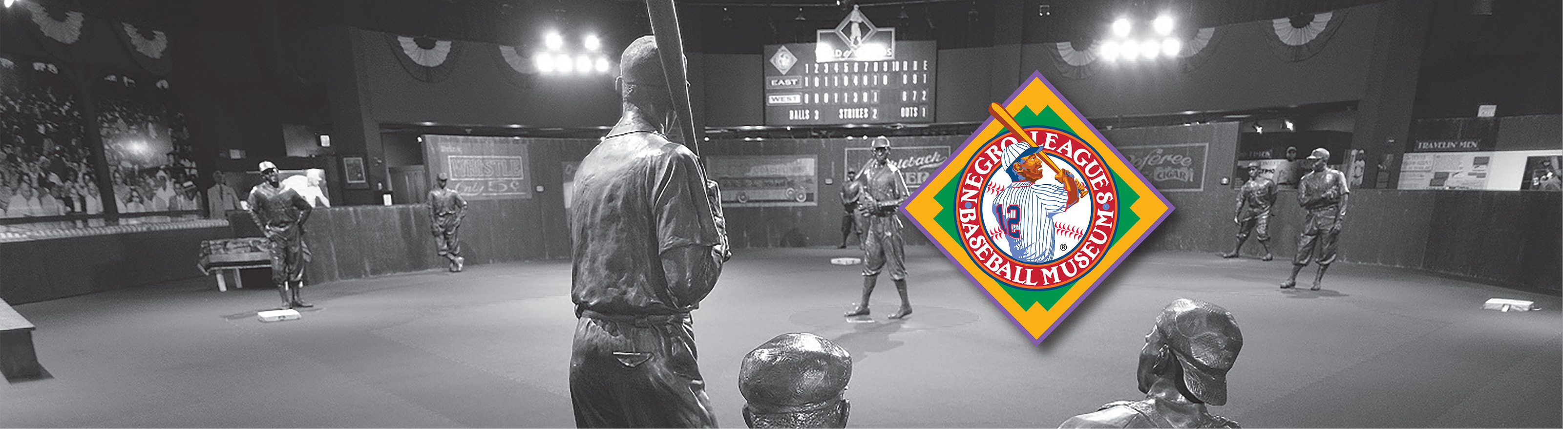 A black & white image of the Field of Legends exhibit & the Negro League Baseball Museum
