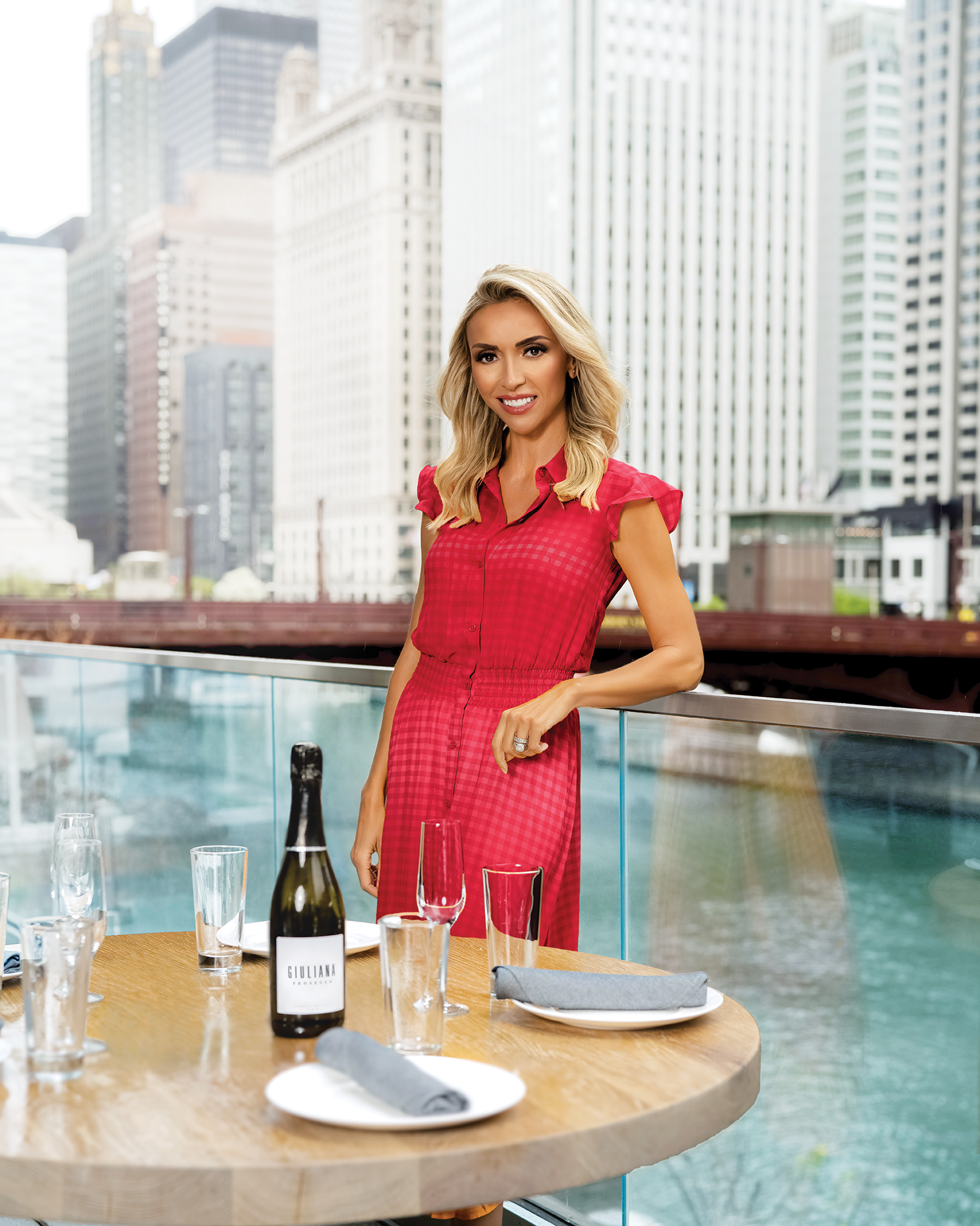 Rooftop city backdrop picture of Giuliana Rancic.