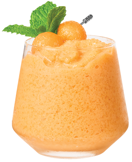Blended Cantaloupe Colada in Glass with Mint Garnish