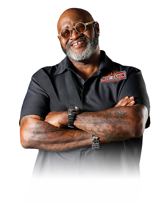 Barbeque Pitmaster Moe Cason smiling with arms folded
