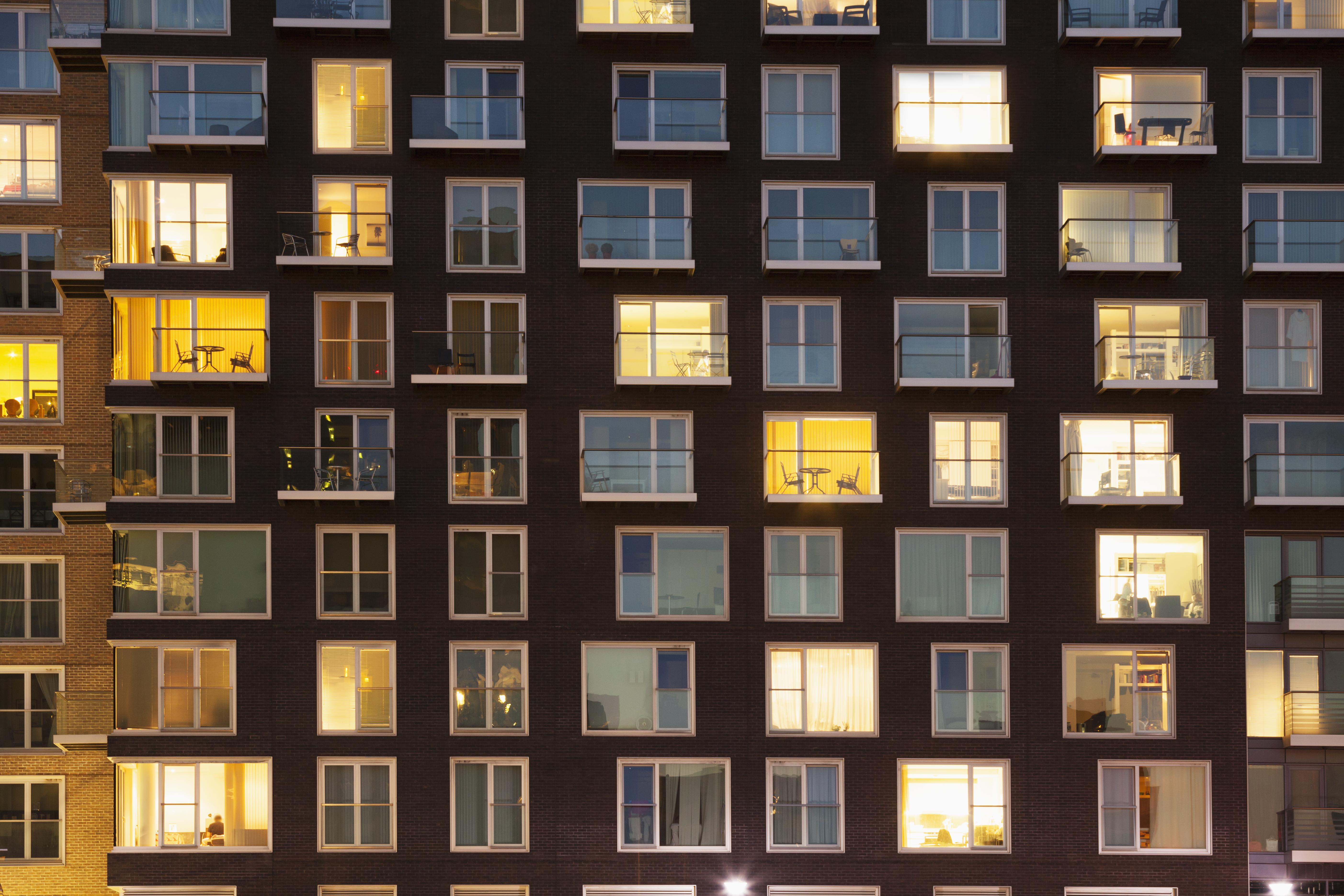 Modern apartment block at dusk themes of urban scene apartment housing
