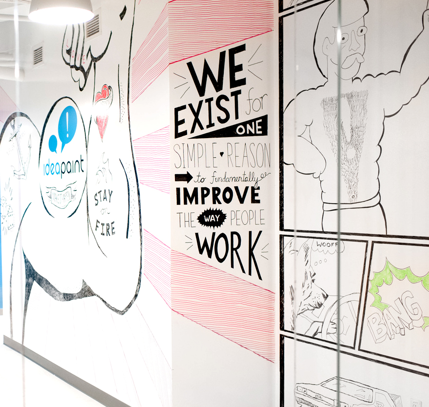 company dry-erase wall with fun drawings and ideapaint logo