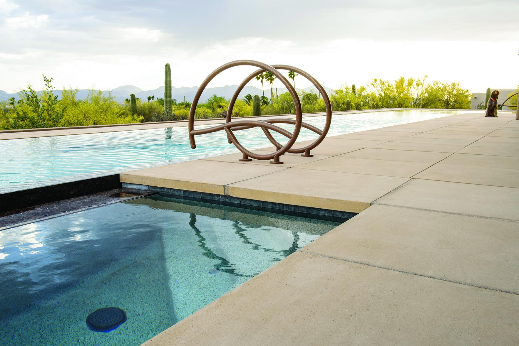 poolside tan stone patio overlooking desert
