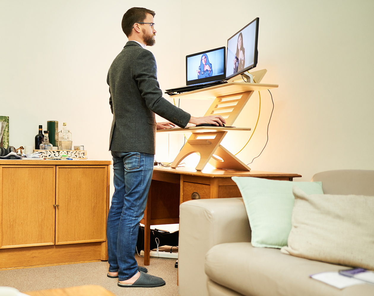 Man using a stand up desk while working at  home