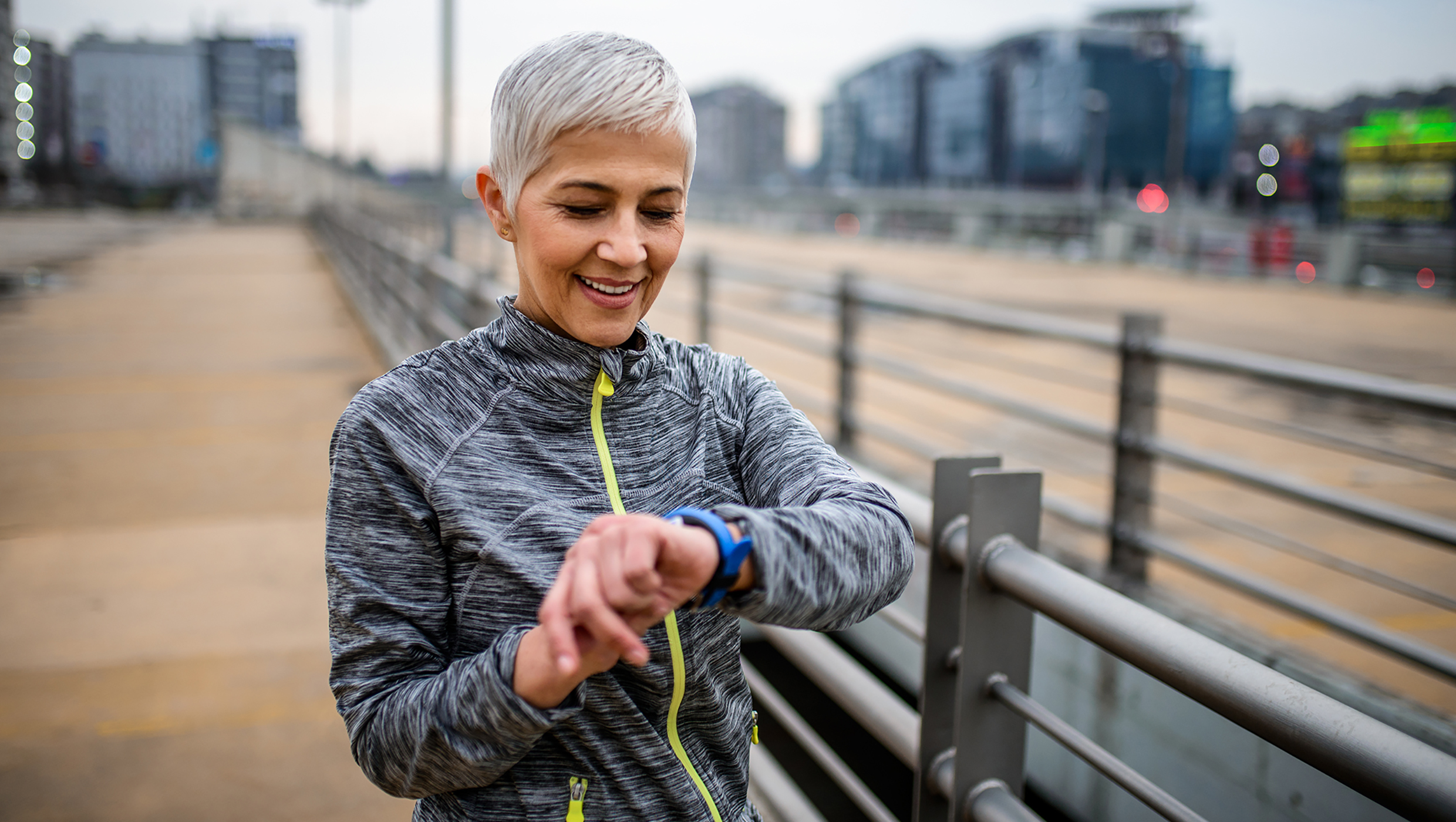 Woman checking her smartwatch after exercising