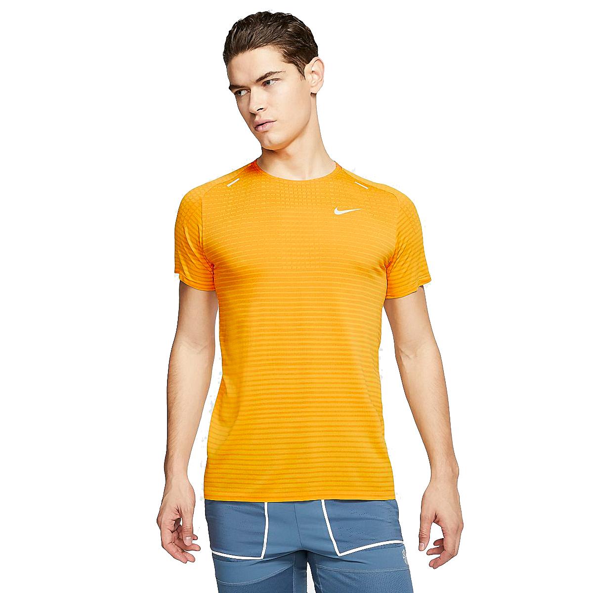 man wearing a yellow nike short sleeve shirt