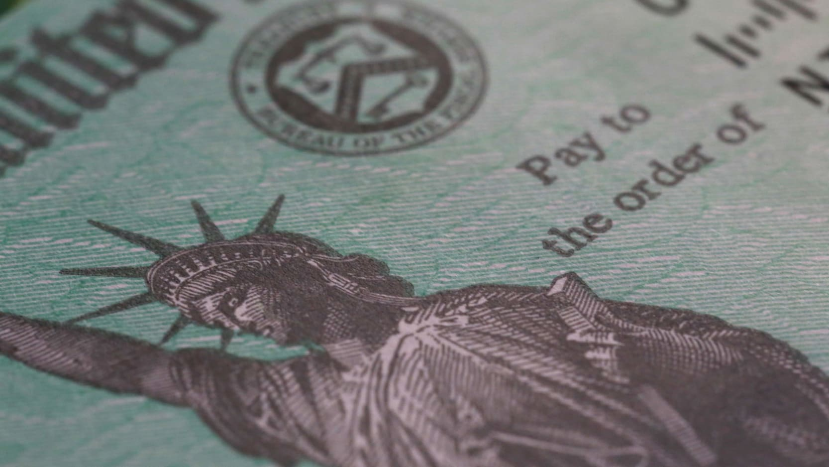 Close-up of a US government check.