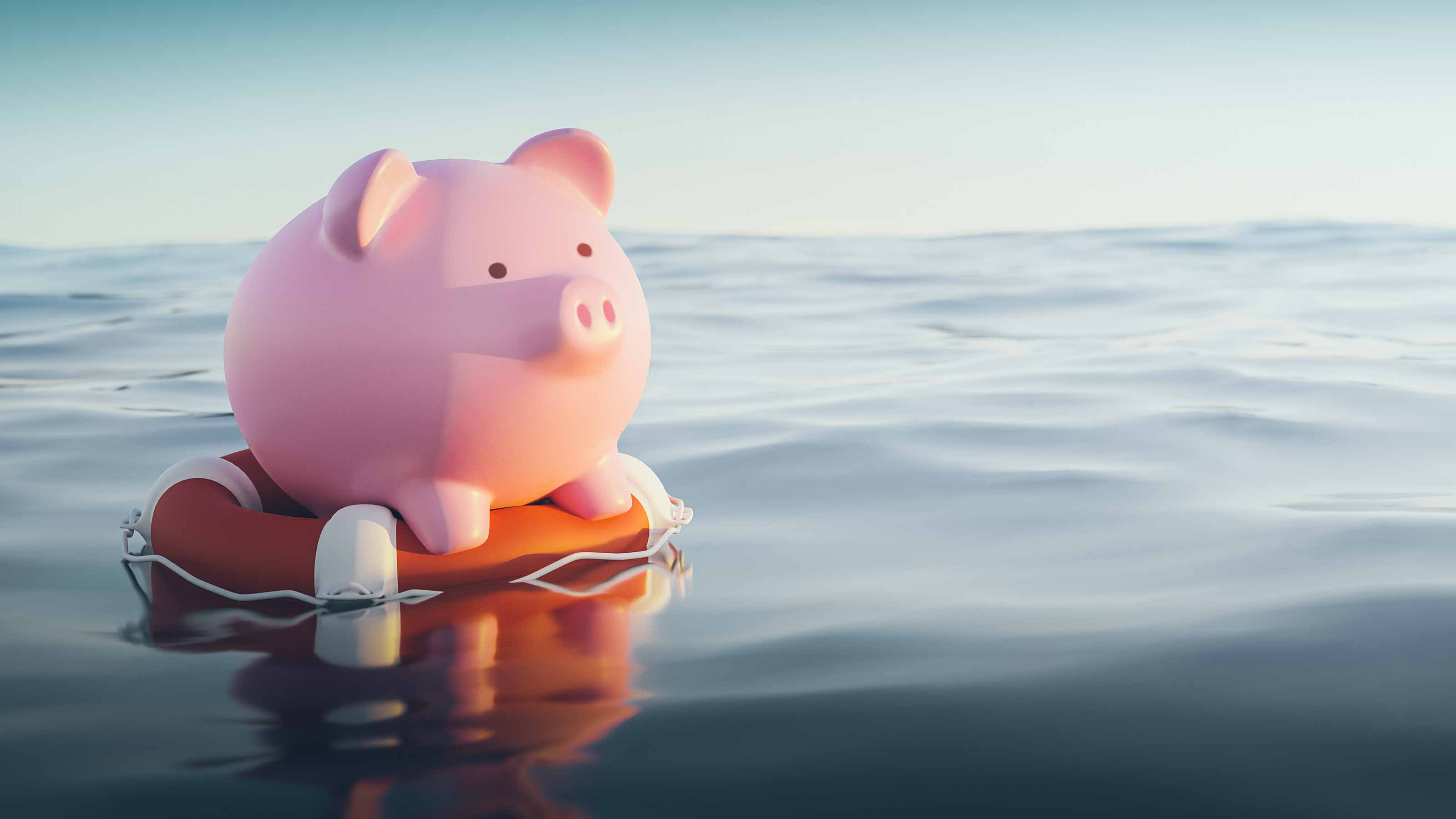 Piggybank floating in water on a life preserver.