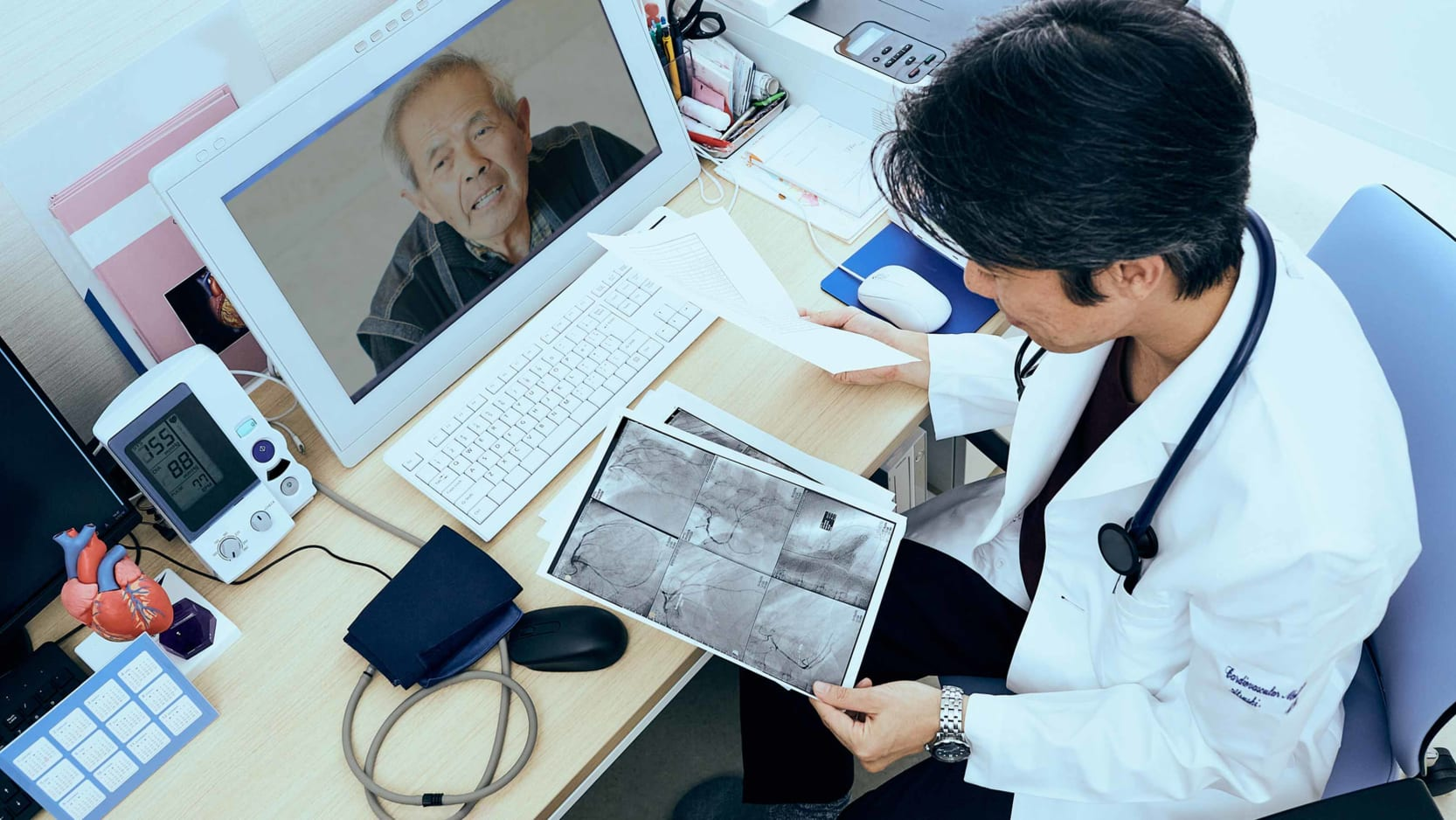 A doctor conducting a telehealth visit with a senior patient.
