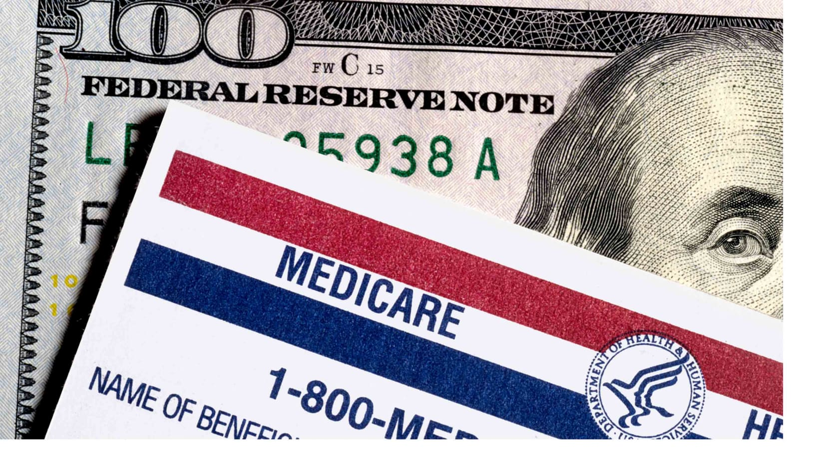 A US $100 bill and a Medicare ID card.