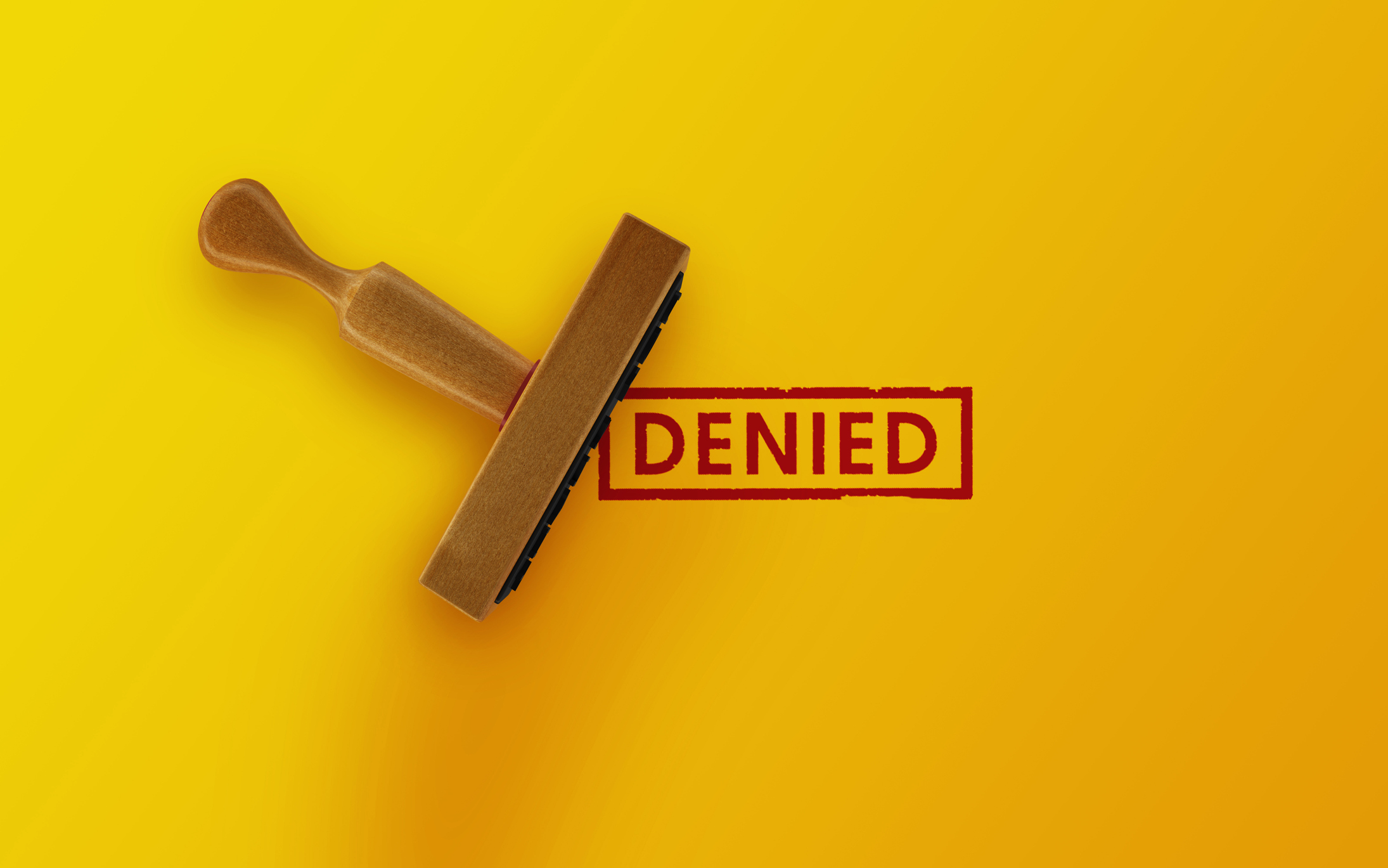 Denied stamp with bright yellow background