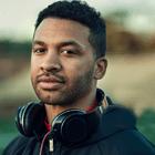 man with headphones around neck