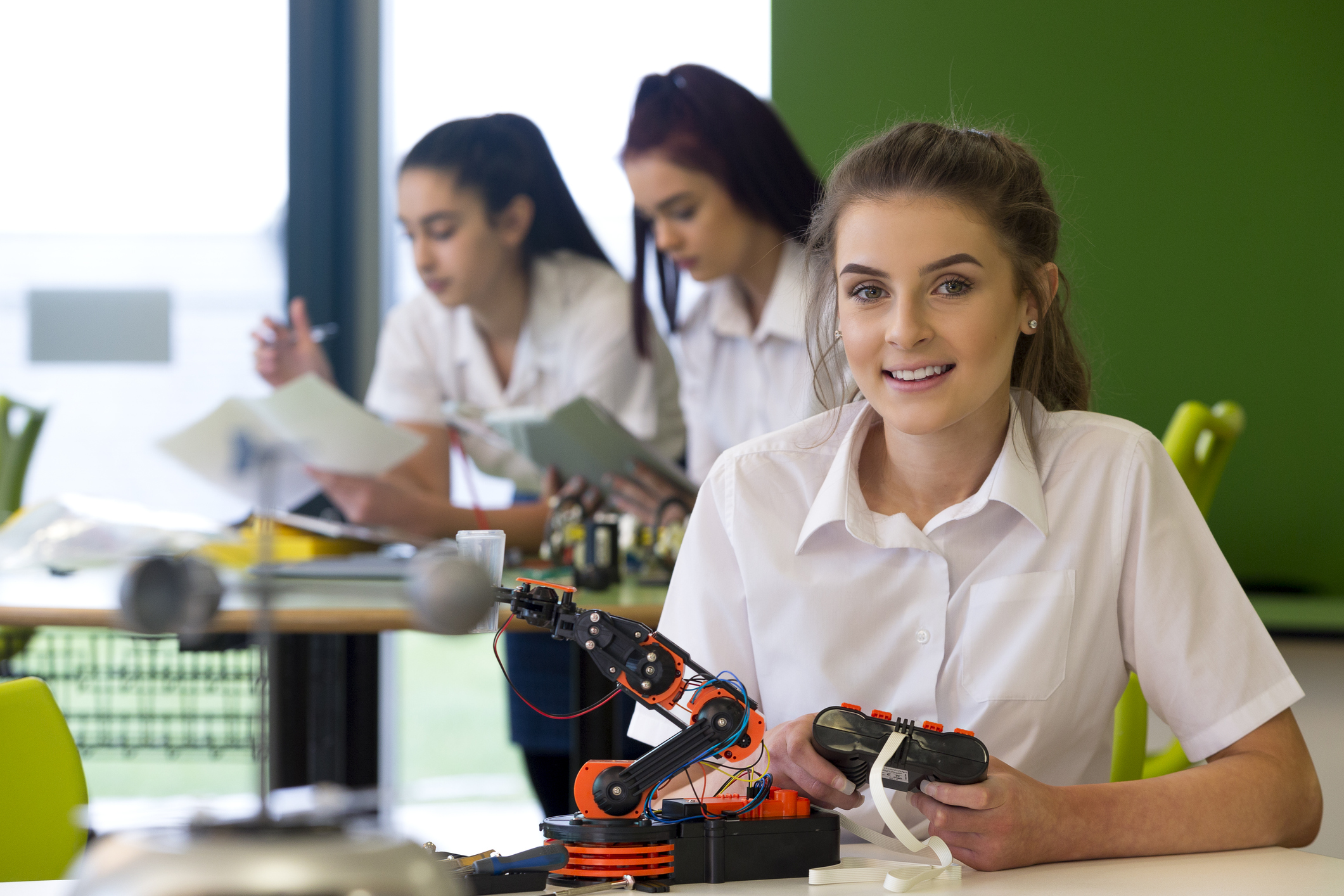 young student is learning robotics