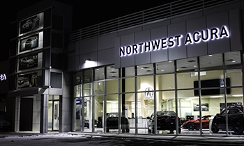Front of the Northwest Acura building with cars in showroom