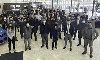 Crowfoot Dodge staff members all wearing masks in their showroom