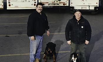 Pete and Andrew with their dogs from Pete the Plumber