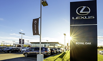 Lexus of Royal Oak sign and parking lot with vehicles