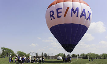 The RE/MAX hot air balloon lifting off the ground