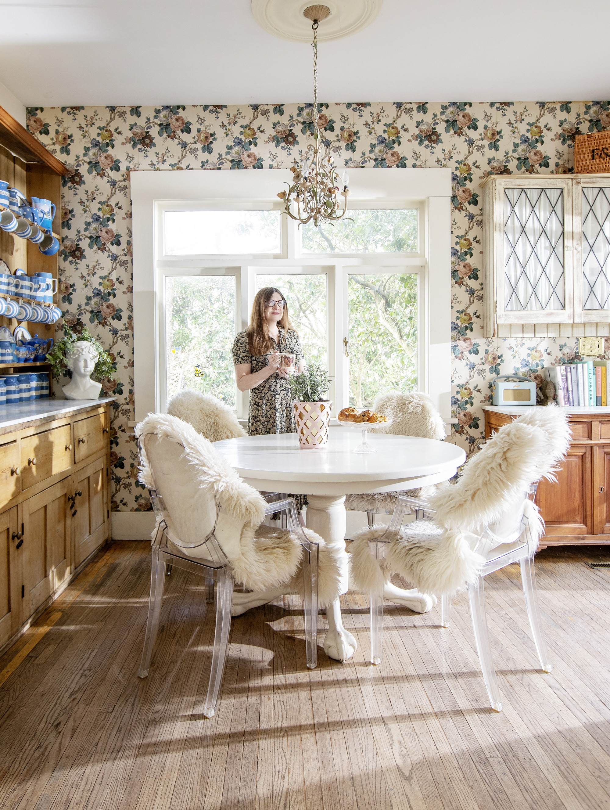Nikki Renshaw in her kitchen with a cup of coffee