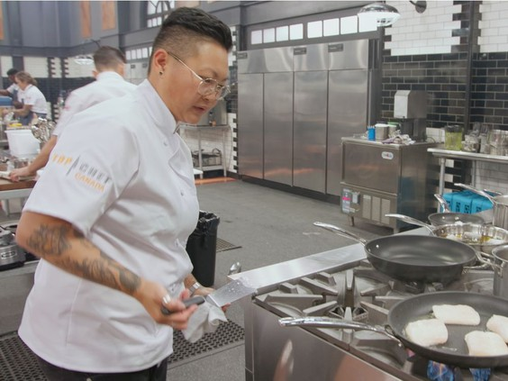 Top Chef Canada chef in kitchen at stove