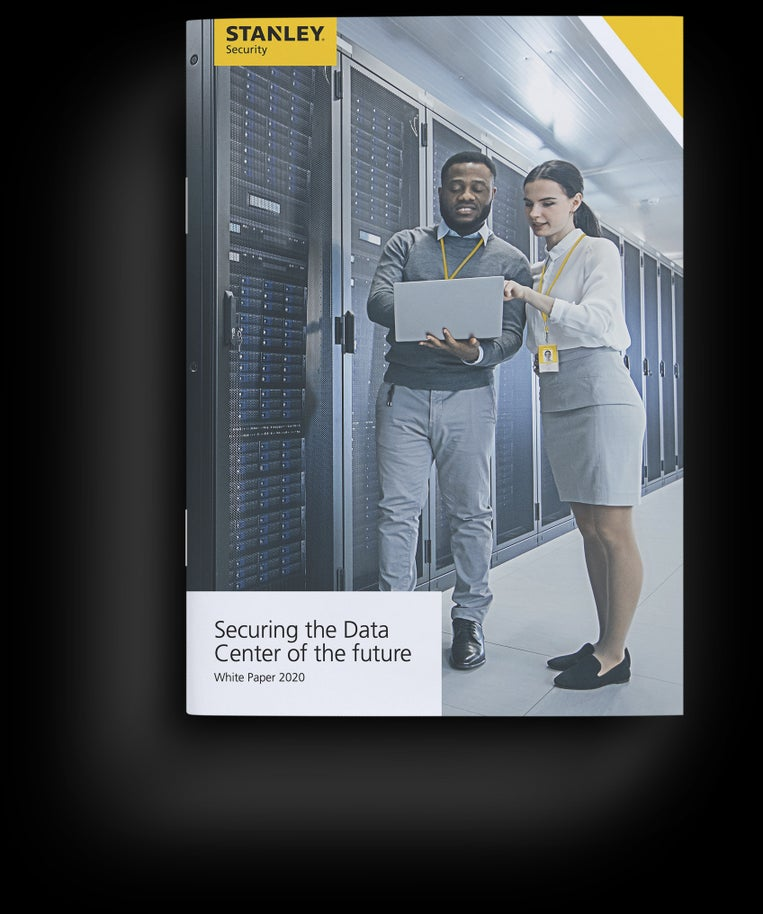 image of the front cover of the ebook showing a male employee discussing server performance with a female colleague whilst looking at a laptop together