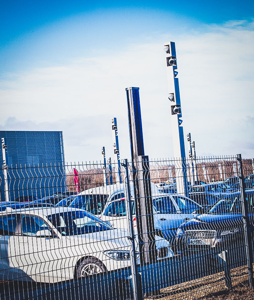 Image of a security fence and cameras around an audi car dealership