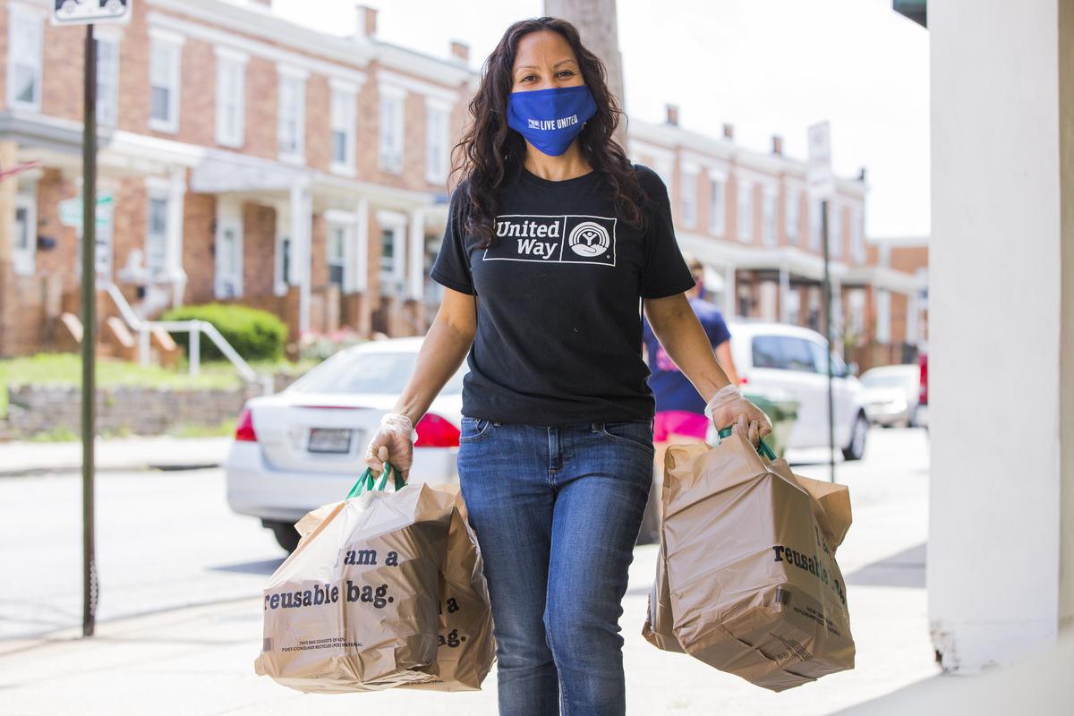 UWCM volunteers distributing food during COVID lockdown