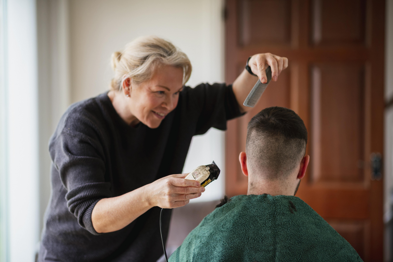 Man getting a haircut as part of the Economic Advancement program