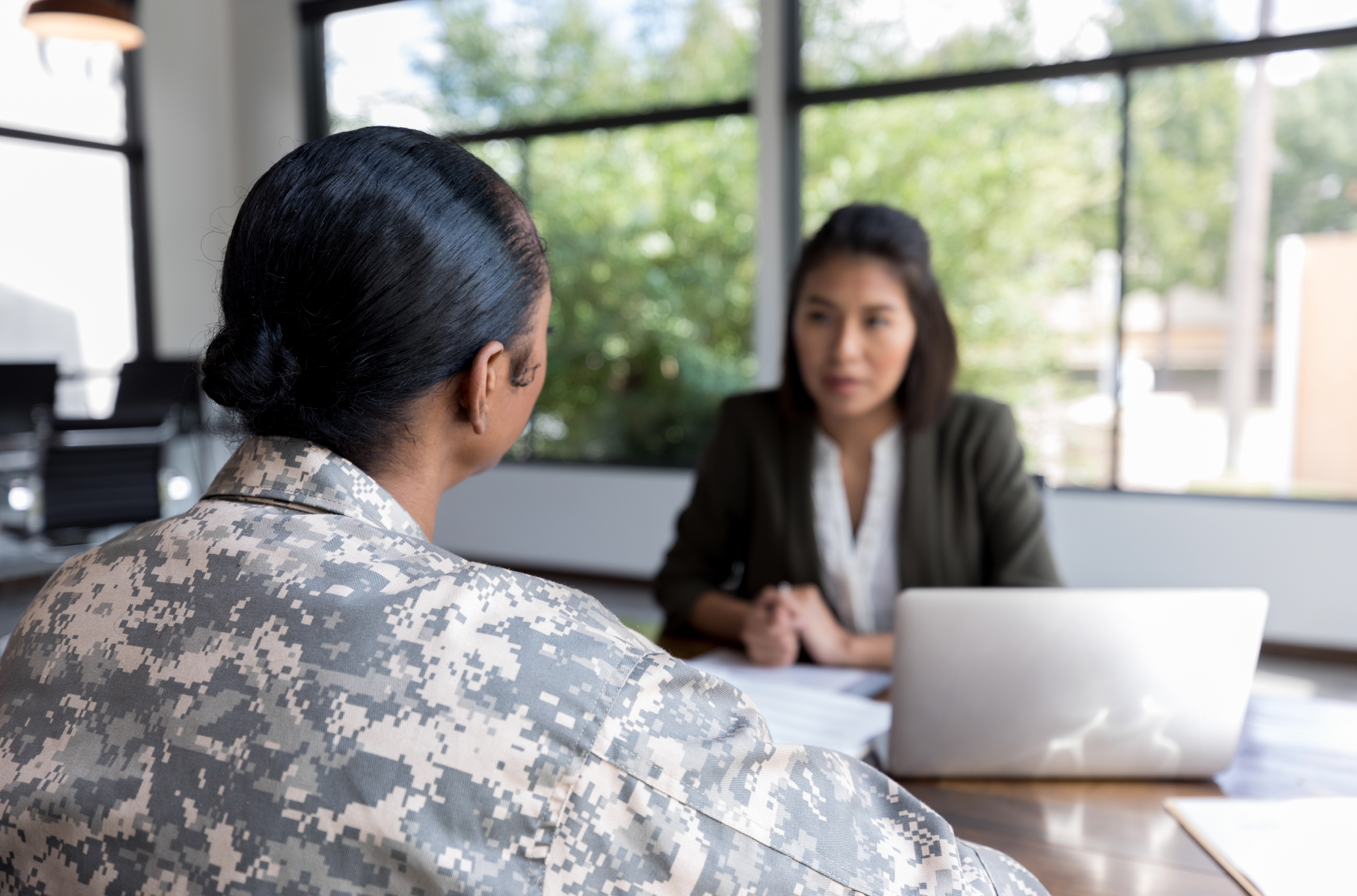 UWCM Veterans Treatment Court photo of woman soldiers receiving counseling